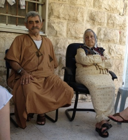 Nabil and his mother. Now without a house due to the settlers.
